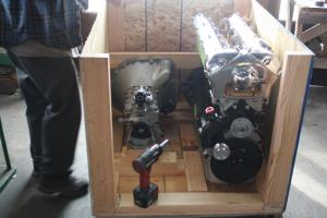 Engine and transmission sitting in a crate